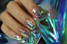 Shattered-Glass Nails Look As Cool As They Sound #refinery29  http://www.refinery29.com/shattered-glass-nail-trends#slide-2  Glass-nail stickers come in two templates — the fragmented shards pictured so far, and this cut-gemstone arrangement. I mean, who doesn't want diamond fingers?...