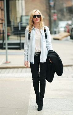 Kate Bosworth wearing black skinny jeans, boots, and a chambray shirt