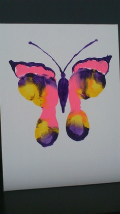 Paint the bottoms of their feet to make butterflies, then personalize it with your own saying on the bottom of the canvas.