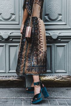 Embellished dress, rich colours and sequins finished with a pair of teal velvet heels.