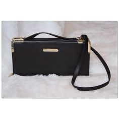 Michael Kors Shoulder Bag/Clutch Michael Kors Black Leather Slim Shoulder Bag With A Detachable Shoulder Strap, Gold-Tone Metal Logo Plate, Gold-Tone Metal Trim And Hardware, Gold Metallic Leather Lining, Zip Around Closure, Interior Zip Compartment, Two Interior Slide Compartments and Six Interior Credit Card Compartments. New, Never Worn Lost Tags. Please Note There Is A scratch On The Gold Metallic Leather Interior Towards The Bottom. Plastic Protective Coating Is Still On Gold-Tone Metal…