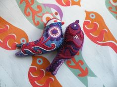 A little birdie told me so! Make these two birds into three dimensional stuffed decorations. Designed and packaged by Nancy Nicholson Designs in the UK, each ki