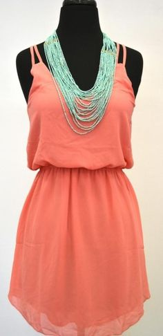 Peach dress w/ teal necklace