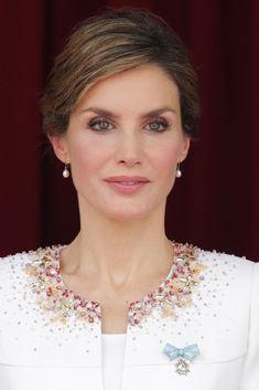 Queen Letizia of Spain attends a ceremony held in honour of the Spanish Guardia Civil at their headquarters, in Vitoria on May 13, 2015. Queen Letizia wore her hair up which showed off her pink pearl drop earrings. On her left chest was pinned the Commander dame's bow of the Order of Charles III which she also wore on the day of the Proclamation.
