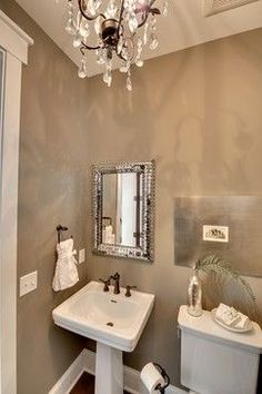 Wall color is Bennington Gray by Benjamin Moore.  Beautiful warm tan.
