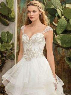 For brides who want to flouce and twirl, the spirited ruffled layers of Style 2308 Paloma will no doubt satisfy, as they cascade down the ballgown skirt of ...