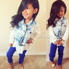 Stylish skinny jeans with long sleeve blouse and denim vest.