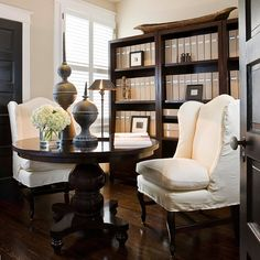 In any home with a formal dining room, consider using it as a home office/library instead. Store your books on shelves along walls and treat it as a library and home office by day. A table in the center can easily be set for guests when its time to enter Home Office Storage, Home Office Decor, Home Decor, Office Ideas, Desk Ideas, Cozy Office, Home Design, Interior Design, Design Room