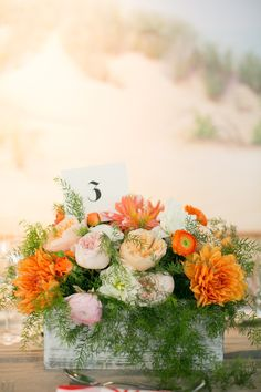 obviously not in orange, and less greenery    Photography by Stacey Hedman Photography / staceyhedman.com, Planning, Styling + Floral Design by lovely little details / lovelylittledetails.com