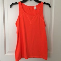 SALEGap Fit Racerback Tank NWOT/never worn! Super cute, soft, absorb any orange Gap Fit workout top. Mesh back for extra breathing room. Absolutely perfect for running, yoga, etc. Could fit XS or S. Color is super fun! GAP Tops Tank Tops