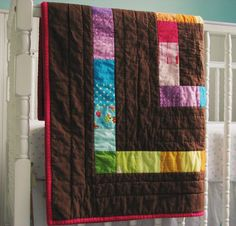 pops of color in chocolate brown... quilt by Blue Elephant Stitch