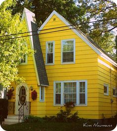 I had a yellow house once, no upstairs (thank goodness) trimmed in green shutters with a white picket fence and a great front porch! People who bought it last made it into a cute shop.