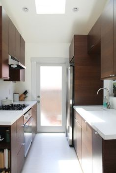 Danielle's Small Modern Cottage: galley kitchen cabinetry: IKEA  • counter tops: Caesar Stone