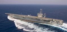 """Drifting Navy style. The ship is the USS Harry S. Truman, the eighth Nimitz-class aircraft carrier in the U.S. Navy fleet, doing a high-speed training maneuver called a """"swing check"""", which is basically a counter steer to stop the movement, or swing, of the ship's bow."""