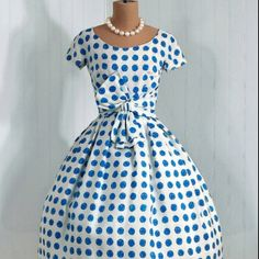 A kiss of spring time in the polka dot swing dress with pearls!