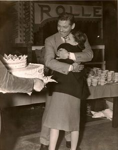 Clark Gable and Judy Garland, 1930s. She just sang for him on his birthday.