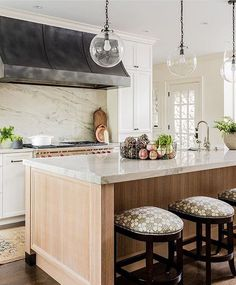 Vintage modern kitchen design with marble counters and backsplash and light wood island with nicely finished ends - Kitchen Ideas & Decor