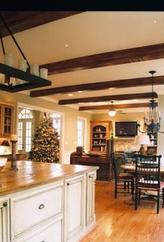 Love the dark beams, candle lighting above the kitchen island and the overall cozy feeling.