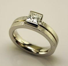 A contemporary diamond ring presented in 14k white gold and featuring a .74 carat E/Si1 Canadian ...