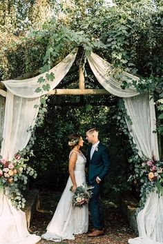 garden wedding arch with romantic florals via plum and oak / http://www.himisspuff.com/greenery-wedding-color-ideas/4/