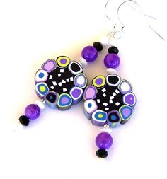 Purple earrings, polymer clay earrings, round earrings, long earrings, simple cane earrings, Op Art earrings mod 1960s by Mindielee