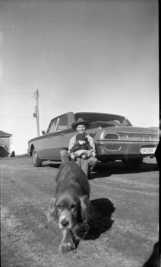 Part Two The sender has informed that they were done in South Dakota.  The photographer opted for a low angle shot here.  The 1960 Ford Galaxie and those handsome boys fit nicely into the portrait orientation. The dog showed up