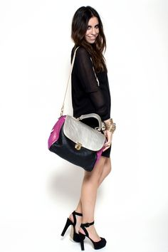 https://www.cityblis.com/4497/item/7760  Silver Schioc Bag - $321 by Les Envers  Schioc_Bag  black leather contrasts are metallic silver and fuchsia glitter color. Light gold datails.   MEASURES:  Width: 33 cm  Depth: 15 cm  Height: 24 cm  Handle height: 10 cm  Removable shoulder strap.   Lining in black canvas. inside pocket and phone case are in leather.   ART-C...