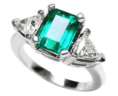 Emerald and Two Round cut Diamond Rings