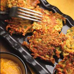 Golden Turmeric Latkes with Applesauce  These crispy-on-the-outside-and-tender-on-the-inside latkes are delicious paired with a subtly spicy clove-scented applesauce.    Turmeric Recipes from Eating Well Magazine