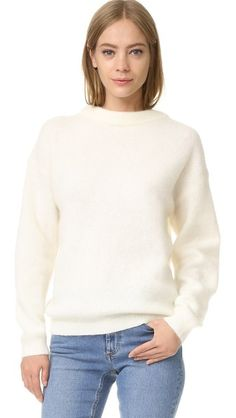 Love this Acne Studios sweater. Not sure why they're calling it 'dramatic' as it's just a plain winter white sweater lol