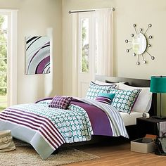 Bring a vibrant look to your bedroom with the lively Halo Reversible Comforter Set. Adorned with a teal and white checkered print, horizontal purple stripes and a grey stripe, the youthful bedding is show-stopping addition to any room's décor.