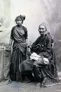 Indonesia | Studio portrait of an Acehnese aristocrate with a young woman.  ca. 1880 - 1908 | Photo by C. B. Nieuwenhuis   |||  Source; http://issuu.com/kitpublishers/docs/living_with_indonesian_art