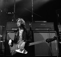 """To be a rock, and not to roll on Instagram: """"Eric Clapton with his Gibson Firebird I (1969) 📸 by Gered Mankowitz ___________________________________________ #ericclapton #cream…"""" Gibson Firebird, Eric Clapton, Concert, Rock, Cream, Instagram, Creme Caramel, Skirt, Concerts"""