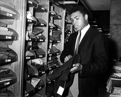 Boxer Cassius M Clay aka Muhammad Ali shopping for clothes in London