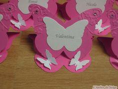 """Bonjour à tous et à toutes ! Voici les Marque-Place réalisés pour le Baptême de Valentina qui aura lieu le 11 juin 2016. Ce sont des marque-place """"Chevalet"""" en forme de Papillon. Ils sont de couleurs Blanc Irisé, Fuchsia et une touche d'Argent. Vue d'ensemble..."""