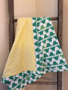 A personal favorite from my Etsy shop https://www.etsy.com/listing/225021252/green-frog-baby-blanket-yellow-minky