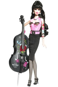 Edgy glam meets sleek style in one decadent doll courtesy of Hard Rock Cafe. Barbie rocks the rockabilly look in a pink bustier with golden and black trim, black pencil skirt, fishnets, and sky high Mary Janes. Cute tattoos decorate the doll arms, and adorable accessories include more than just the usual bling. A rockin bass guitar to jam with the band accompanies this rock star! I want this so much!