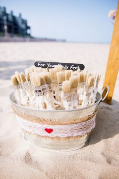 """""""For your sandy feet!"""" Your guests will appreciate the thought of paintbrushes to brush away sand at your beach wedding! {@offbeetpro}"""