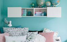 Luzie's pastel blue walls and monochrome textiles complement each other