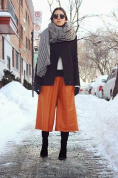 Shop this look on Lookastic:  https://lookastic.com/women/looks/biker-jacket-culottes-knee-high-boots-gloves-scarf/13543  — White and Black Houndstooth Scarf  — Black Wool Biker Jacket  — Black Leather Gloves  — Orange Culottes  — Black Suede Knee High Boots