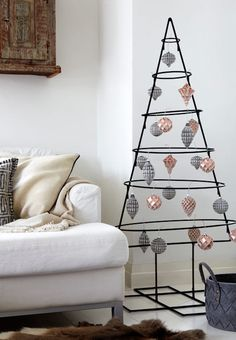 Creative alternative Christmas trees show unusual designs and offer fantastic holiday decor ideas to add a contemporary vibe to the winter season Industrial Christmas Trees, Creative Christmas Trees, Black Christmas Trees, Christmas Tree Design, Christmas Tree Crafts, Christmas Mood, Modern Christmas, Christmas Projects, Alternative Christmas Tree