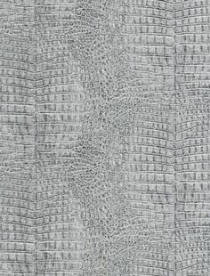 Silver crocodile wallpaper. Adds texture and interest to the space.