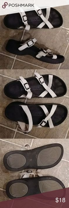 Woman's BIRKENSTICK Tatami white Sandals 40 9 White man made material straps. 2 buckles. Size 40 / 9 US woman's. Footprint on insole is solid. Pre owned. Small tear on the steap on the left shoe. See photo. Does not affect the wear of these shoes. Birkenstock Shoes Sandals