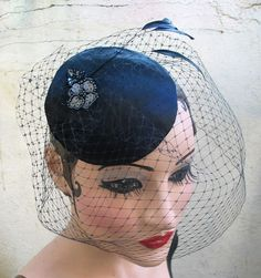 Weddings, Black Birdcage Veil, Feather Fascinator, Cocktail Hat, Rockabilly, Pin Up, Head Piece, 1940's,Batcakes Couture. $74.95, via Etsy.