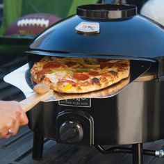 Forget burgers and franks for tailgating! Create a delicious pie in less than 5 minutes with this Portable Pizza Oven.