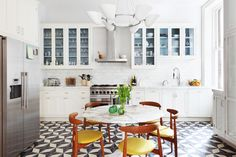 Looking for kitchen flooring? This mid-century kitchen uses unusual tiles. Browse hundreds more kitchen images to design your dream kitchen.