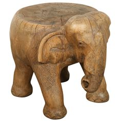 Hand-carved Elephant Stool | 1stdibs.com Celine's Office  PRICE:$950 Purchase > CREATOR:African- Tribal (Sculptor) IN THE STYLE OF:Tribal COUNTRY:Thailand DATE OF MANUFACTURE:19th century MATERIALS:wood CONDITION:Distressed WEAR:Wear consistent with age and use HEIGHT:13.5 in. (34 cm) DIAMETER:14 in. (36 cm)