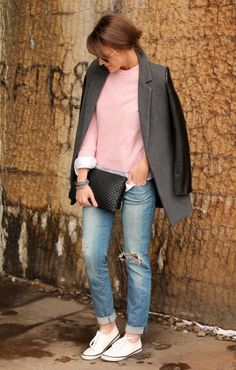 Shop this look on Lookastic:  http://lookastic.com/women/looks/crew-neck-sweater-dress-shirt-bracelet-clutch-jeans-low-top-sneakers-coat/7935  — Pink Crew-neck Sweater  — White Dress Shirt  — Silver Bracelet  — Black Leather Clutch  — Light Blue Ripped Jeans  — White Low Top Sneakers  — Charcoal Leather Coat