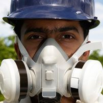 HSE - Respiratory protective equipment (RPE) Man wearing protective mask