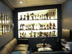 action figure display - Will & Tay would love this for the entertainment/game room